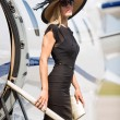 Wealthy Woman Getting Off Private Jet — Stock Photo #38701025