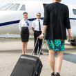 Stock Photo: BusinesswomWith Luggage Walking Towards Private Plane