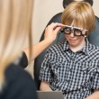 Постер, плакат: Optician Determining Prescription Values With Trial Frame For Bo