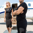WomWith Bodyguard Against Private Jet — Stock Photo #38705013