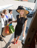 Confident Woman Carrying Shopping Bags While Boarding Private Je — Stock Photo