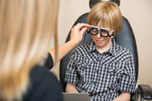 Optician Determining Prescription Values With Trial Frame For Bo — Stock Photo
