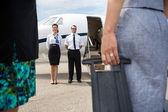Pilot And Airhostess Standing Near Private Jet — Stock Photo