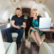 Business Colleagues Discussing On Private Jet — Stock Photo