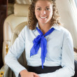 Happy Airhostess Sitting In Private Jet — 图库照片