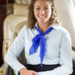 Happy Airhostess Sitting In Private Jet — Stockfoto
