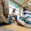 Teacher Reading To Students In Library — Stock Photo