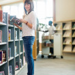 College Student Holding Book In Bookstore — Stock Photo