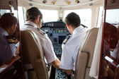 Pilot And Copilot In Cockpit Of Corporate Jet — Stock Photo