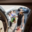 Rich Woman With Shopping Bags Boarding Private Jet — Stock Photo #38838603