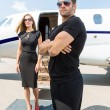 Bodyguard Standing Against Elegant WomAnd Private Jet — Stock Photo #38837557