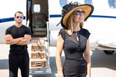 Happy Woman With Bodyguard And Private Jet In Background — Stock Photo