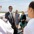 Business People Greeting Pilot And Airhostess At Airport Termina — Stock Photo #38844707
