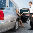 Pilot Helping Woman Stepping Out Of Car At Terminal — Stock Photo