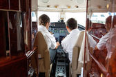 Pilots Operating Controls Of Private Jet — Stock Photo