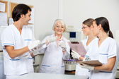 Scientists Discussing Over Sample In Laboratory — Stock Photo