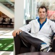 Confident Male Doctor Sitting On Chair — Stock Photo #38960493