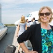 Happy Businesswoman Against Private Jet — Photo