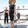 Beautiful WomWith Bodyguard And Airhostess Against Private Je — Stock Photo #38964985