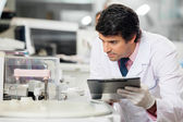 Scientist Observing Experiment — Stock Photo