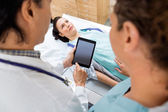 Medical Team With Patient In Hospital Room — Stock Photo