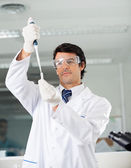 Confident Scientist Filling Solution Into Test Tube — Stock Photo