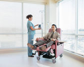 Nurse Operating IV Machine For Patient During Chemotherapy — Stock Photo