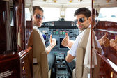 Pilots Gesturing Thumbs Up In Cockpit — Stock Photo