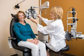 Eye Specialist Adjusting Phoropter For Woman — Stock Photo