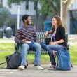 Students Sitting On Bench At University Campus — Stock Photo
