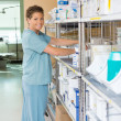 Female Nurse Working In Storage Room — Stock Photo