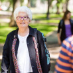 Senior Female Professor Standing On Campus — Stock Photo #39298039
