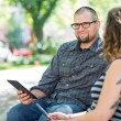 Smiling University Student Sitting With Friend On Campus — Stock Photo #39298083