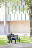 University Student Sitting On Bench At Campus — Stock Photo