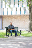 Mid Adult Student Sitting On Bench At Campus — Stock Photo