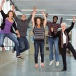 Excited Multiethnic University Students Jumping — Stock Photo #39611519