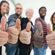 Multiethnic University Students Gesturing Thumbsup — Stock Photo #39611763