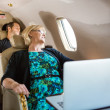 Business People Sleeping On Plane — Stockfoto