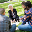 University Professor Outdoors with Students — Stock Photo