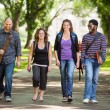 Multiethnic University Students Walking On Campus — Stock Photo #39619429