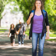 Confident Female Student Walking On Campus Road — Stock Photo #39619633