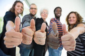 Multiethnic University Students Gesturing Thumbsup — Stock Photo