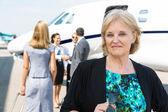 Portrait Of Confident Businesswoman Against Private Jet — Stock Photo