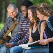 Students Using Digital Tablet Together On Campus — Stock Photo #39620787