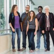 Happy Multiethnic University Students At Corridor — Stock Photo #39754401