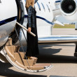 Woman Stepping Out Of Private Jet — Stock Photo