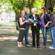 Stock Photo: Student Discussing Notes With Classmates On Campus