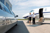Flight Attendant And Pilot Neat Limousine And Private Jet — Stock Photo