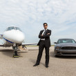 Businessman Standing By Car And Private Jet At Terminal — Stock Photo #40073085