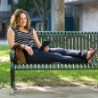 Female University Student Relaxing On Bench — Stock Photo
